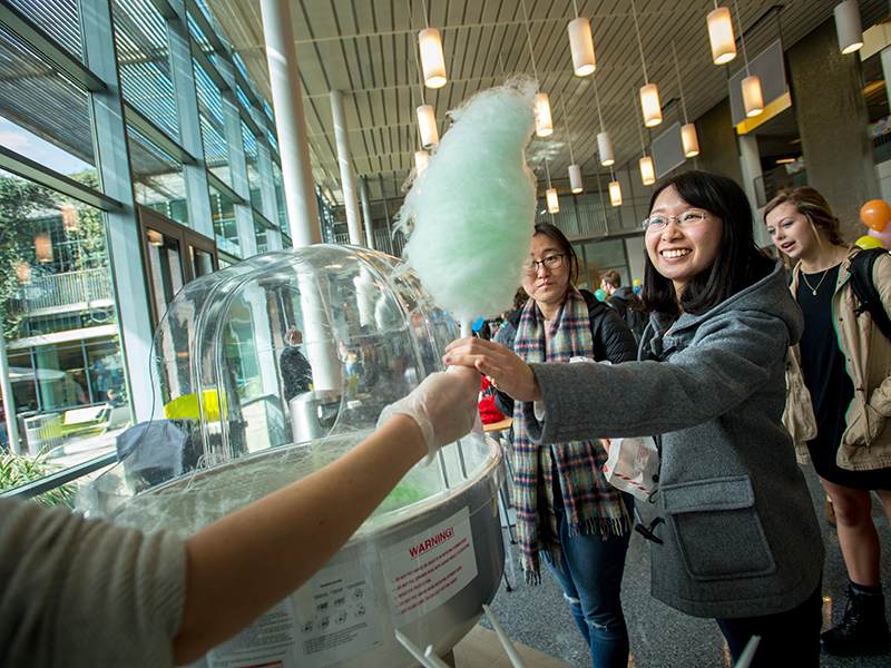 Students enjoy cotton candy in the LBC