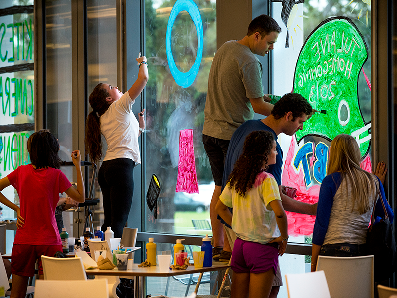 Students paint window for Homecoming